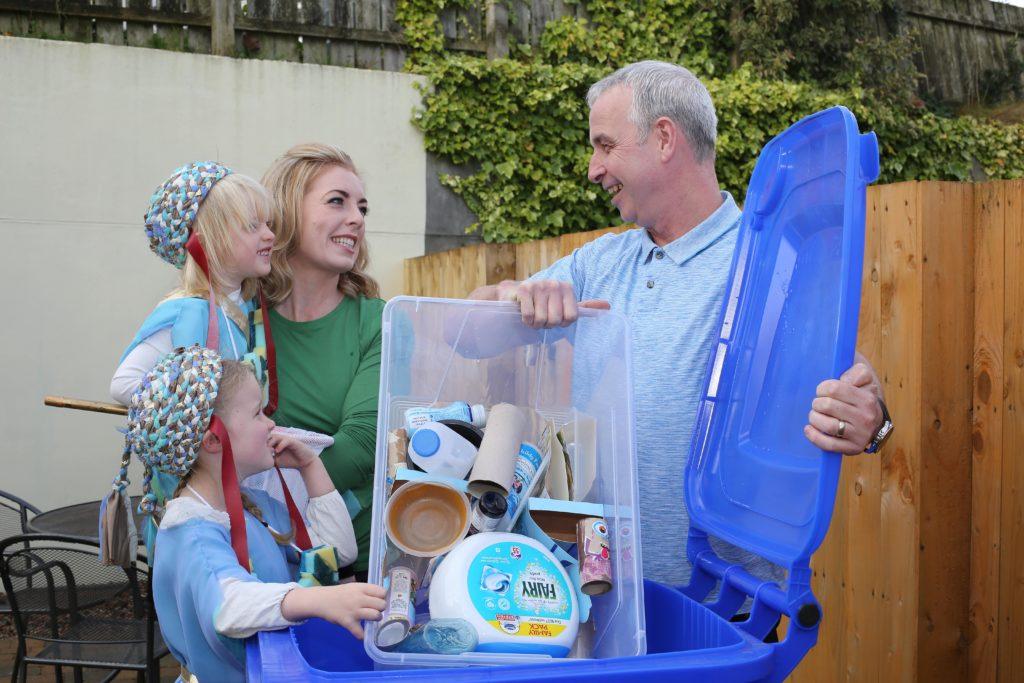 Recycling family blue bin
